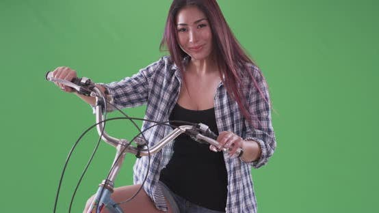 Thumbnail for asian woman smiling with her bike on green screen