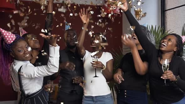 African Friends with Glass of Champanage on the Birthday Party