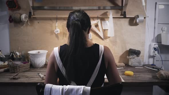 Thumbnail for Woman works in pottery workshop