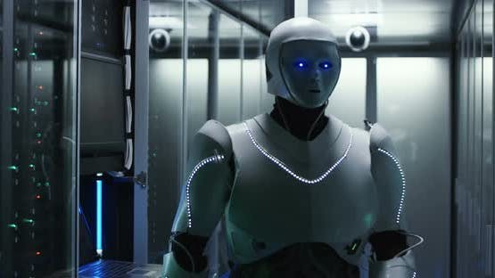 Glowing Robot Working in Server Room of Data Center