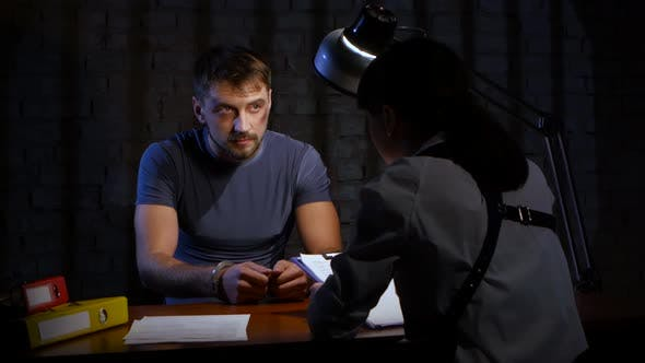 Thumbnail for Interrogation of Criminal Man in Handcuffs