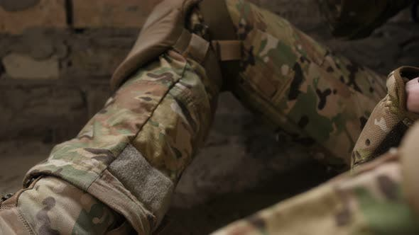 Cigarette in Army Soldiers' Trembling Hands