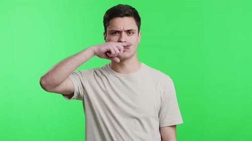 Young Guy Making Moustache Gesture with Finger