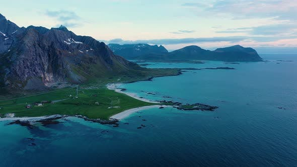 Thumbnail for Fly over the sea and view on Flakstad and Skagsanden beach,Lofoten Islands