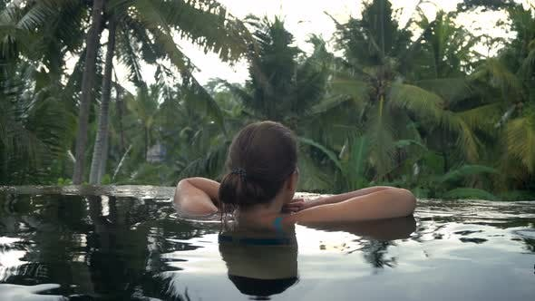 Thumbnail for Young Woman Restingin the Pool in the Tropical Garden
