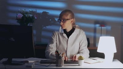 Smart Female Engineer Working on Computer and Enjoying Success in Work