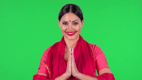 Portrait of a Young Indian Girl in National Classic Red Sari Is Looking Straight Is Smiles and