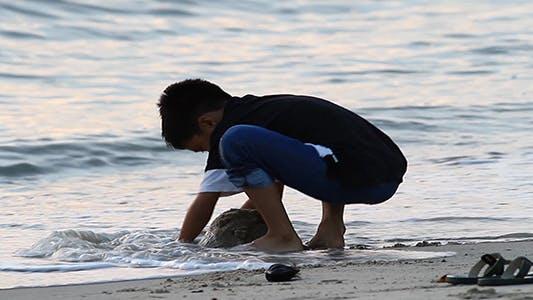 Boy and Sunset Beach
