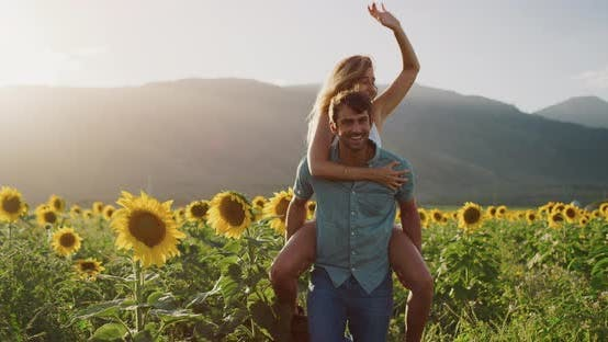 Thumbnail for Happy couple in sunflower fields