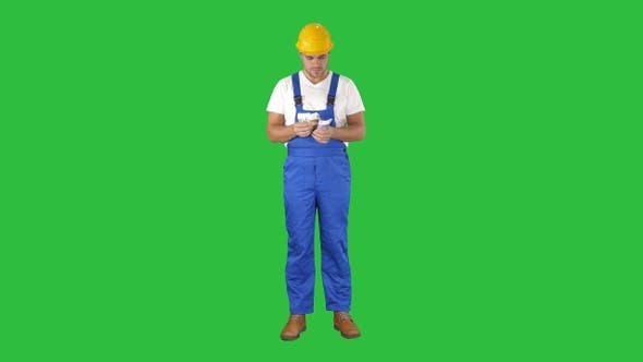 Thumbnail for Builder counting money standing on a Green Screen, Chroma Key.