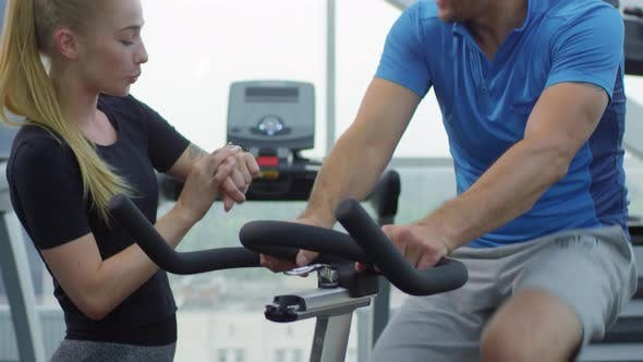 Man Using Stationary Bicycle with Trainer
