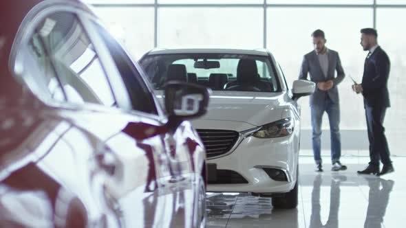 Thumbnail for Salesman Helping Businessman Choosing Car