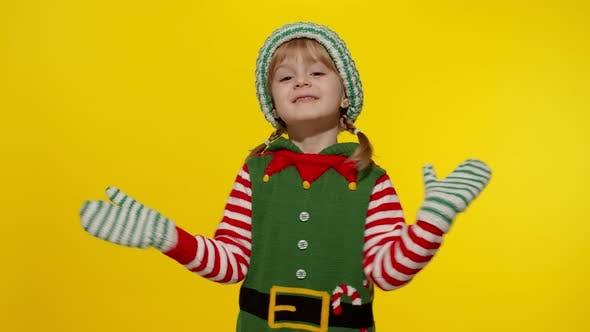 Kid Girl in Christmas Elf Santa Helper Costume Dancing Fooling Around