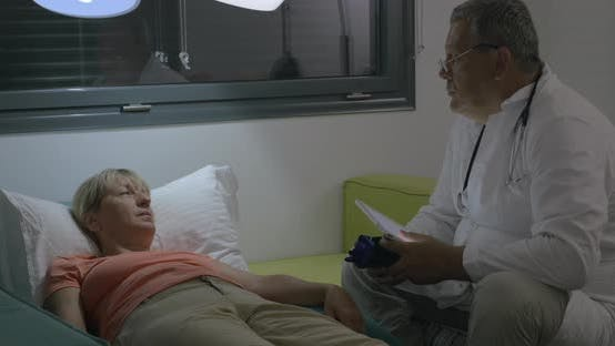 Doctor Consulting a Sick Woman at Home