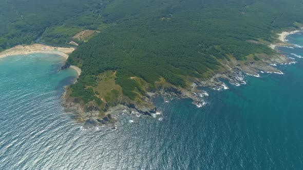 Thumbnail for Rocky Coastline with Crop Fields. Waves Crashing Against Cliffs