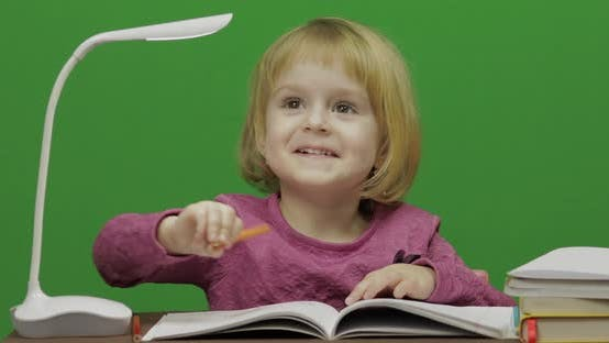 Thumbnail for Girl Drawing at the Table. Education Process in Classroom. Chroma Key