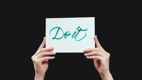 Go It Aspirational Slogan in Hands