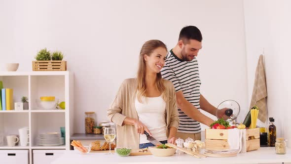 Cover Image for Happy Couple Cooking Food at Home Kitchen