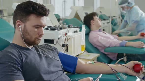 Thumbnail for Blood Donor Listening to Music on Phone