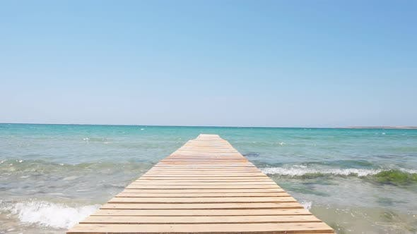 Thumbnail for Slow-motion Video of Wooden Pier Against the Backdrop of Turquoise Sea