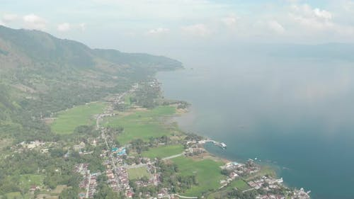 Aerial: lake Toba and Samosir Island from above Sumatra Indonesia. Huge volcanic