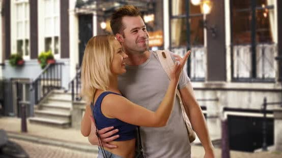 Thumbnail for Excited white woman girlfriend points to places she wants to show her boyfriend