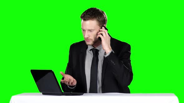 Cover Image for Businessman Sitting and Talking on the Phone. Green Screen