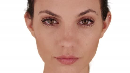 Thumbnail for Close-up of pretty female on white copy space looking intently at camera alone