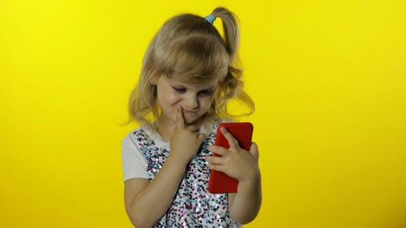 Thumbnail for Child Girl Scrolling Social Network Posts on Smartphone. Remote Online Shopping, Browsing on Phone.