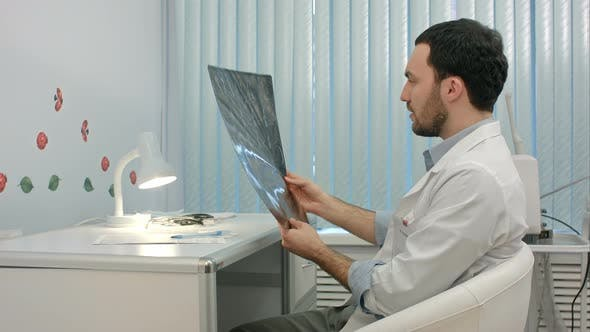 Thumbnail for Doctor Looking at the X-ray Picture of Lungs in Hospital