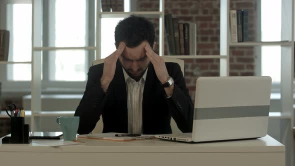 Thumbnail for Depressed Businessman Sitting at Computer