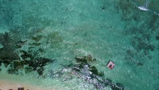 Thumbnail for Tropical birds eye tourism shot of a white sand paradise beach and blue water background in colorful