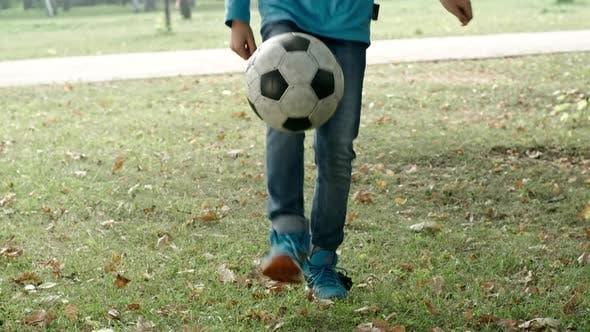 Thumbnail for Boy Kicking Football