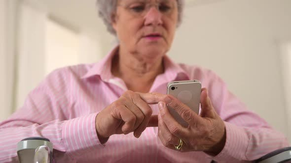 Thumbnail for Old woman happily using smartphone