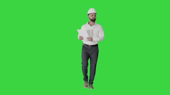 Male Site Contractor Engineer Hard Hat Walking Looking Object Into Papers Documents Green Screen