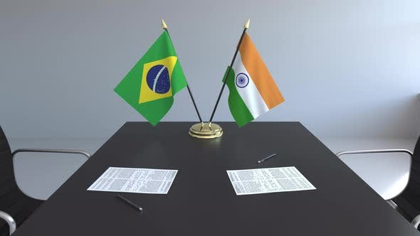 Flags of Brazil and India on the Table
