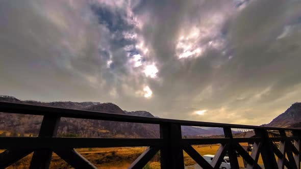 Thumbnail for Timelapse of Wooden Fence on High Terrace at Mountain Landscape with Clouds