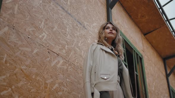Thumbnail for Dreamy Female Looking Away in Barn