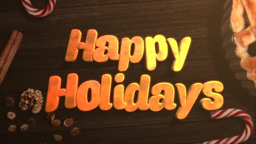 Animated close up Happy Holidays text, candy and Christmas pie on wood background