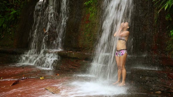 Thumbnail for Taking A Shower In Waterfall