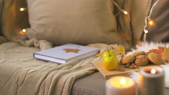 Thumbnail for Book, Autumn Leaves, Nuts and Cookies on Sofa