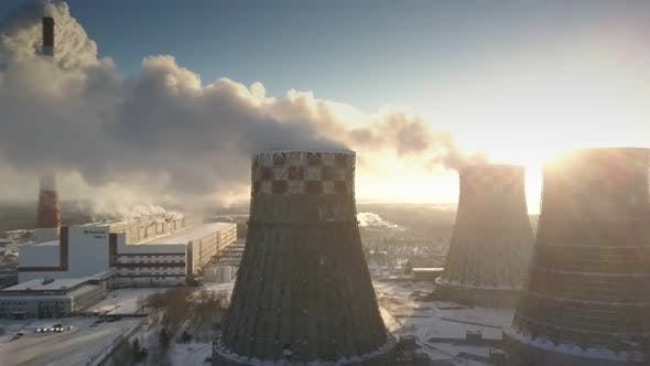 Thumbnail for Bird Eye Flight Cooling Towers with Steam Clouds at Sunrise