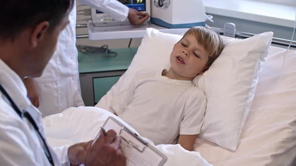 Thumbnail for Child on Hospital Bed Talking to Doctor