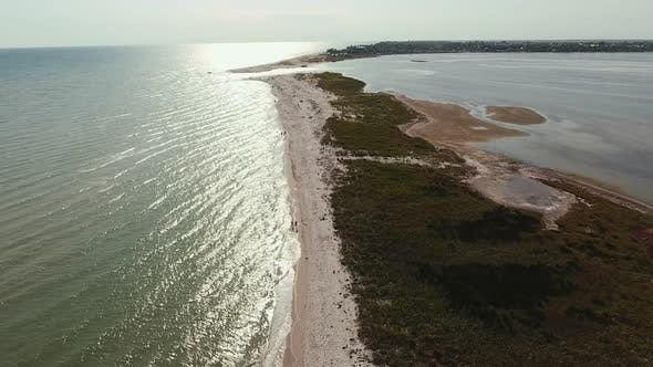 Thumbnail for Aerial Shot of a Straight Sandspit Touching a Curvy Line at Sunset in Summer