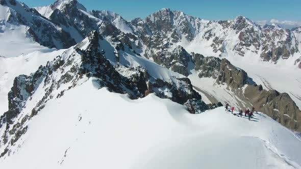 Thumbnail for Blue Snow-Capped Mountains in Sunny Day. Aerial View