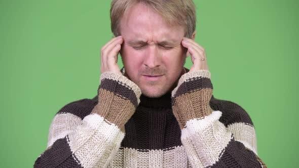 Thumbnail for Studio Shot of Stressed Man Having Headache
