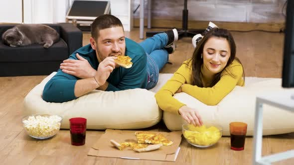Thumbnail for Attractive Couple Relaxing on Pillows for the Floor