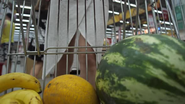 Thumbnail for Woman Putting Fruits in Shopping Cart in Market