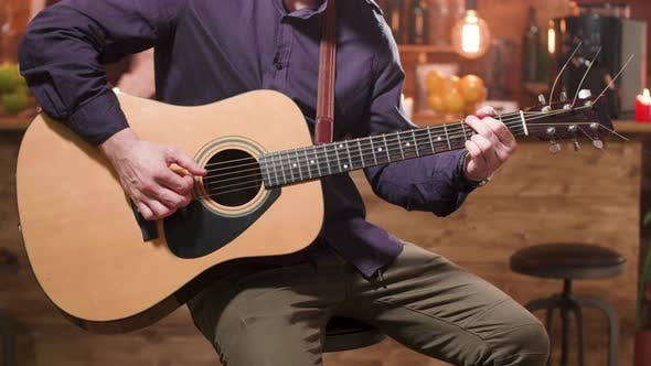 Thumbnail for Acoustic Guitar and Male Hands Playing on It