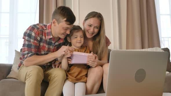 Thumbnail for Family Opens Gift of Daughter Celebrating Birthday Online